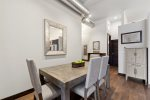 The kitchen has stainless steel appliances and a beautiful brick backsplash